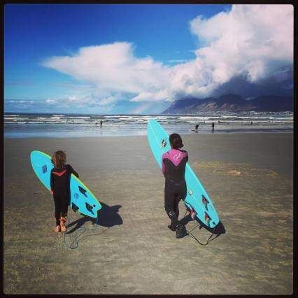 Roushanna and Tai surfing